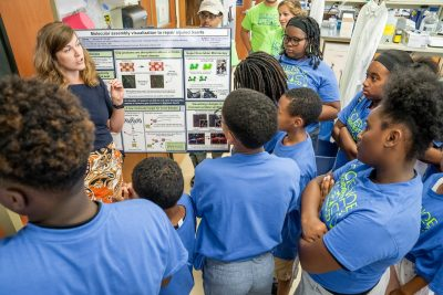 Carissa James, Ph.D., is teaching local youth about heart cell communication prior to completing her doctoral degree at VIrginia Tech