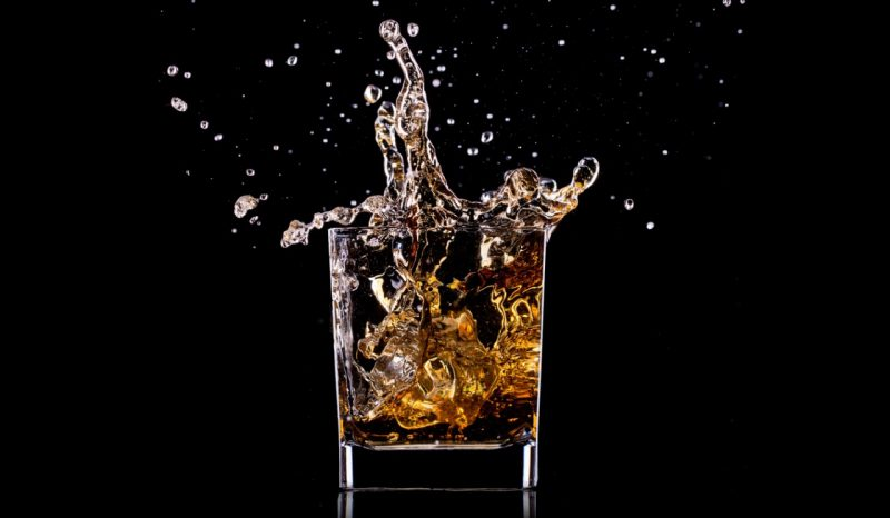 A splashing glass of alcohol