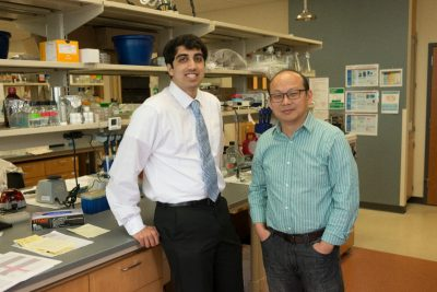 Pratik Kanabur and Zhi Sheng stand in the Sheng Laboratory.