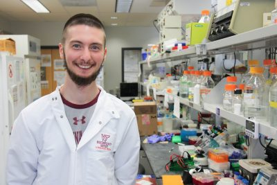 Graduate student Jesse Janoski poses inside a cancer research laboratory at Virginia Tech